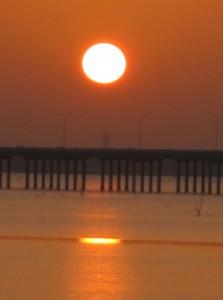 Hazy Sunrise on Lake Ray Hubbzrd (Photo by Nancy Ward)