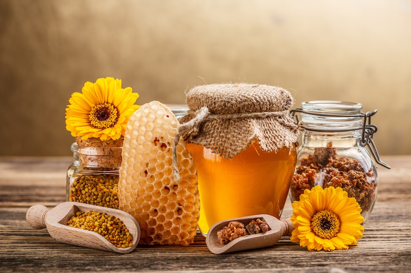 Still life with honey, honeycomb, pollen and propolis by Grafvision (DollarPhotoClub.com)