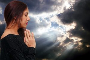 Beautiful Hispanic Latino Christian woman in deep prayer by Rob Byron (dollarphotoclub.com)